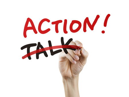 talk replaced by action written by hand on a transparent board Stock Photo