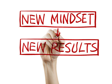 new mindset for new results words written by hand on a transparent board Foto de archivo