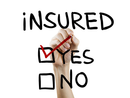 insured: yes insured words written by hand on a transparent board Stock Photo