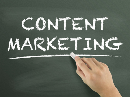 article marketing: content marketing words written by hand on blackboard Stock Photo