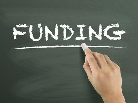 crowd sourcing: funding word written by hand on blackboard