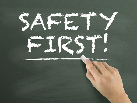 safety first: safety first words written by hand on blackboard Stock Photo