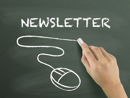 newsletter word written by hand on blackboard