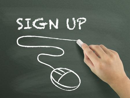 registration: sign up words written by hand on blackboard