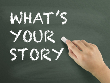 photo story: what is your story words written by hand on blackboard