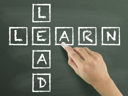 competencies: learn-lead crossword written by hand isolated on blackboard