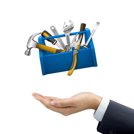 business tool: businessmans hand holding tools box over white background