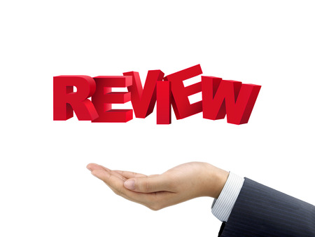 business review: businessmans hand holding review words over white background