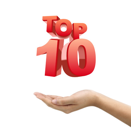 businessmans hand holding top 10 words over white background