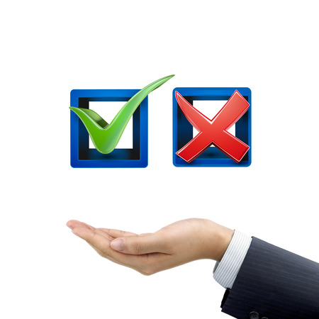 endorsing: businessmans hand holding red and green check mark icons over white background