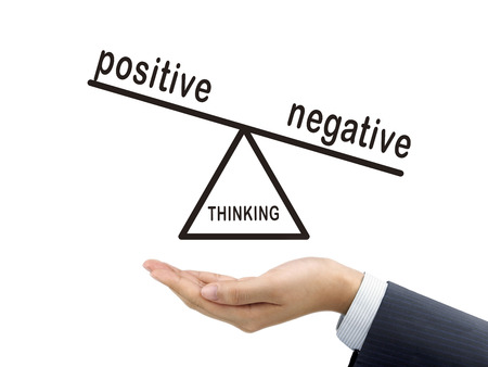 conclusive: thinking negative holding by businessmans hand over white background