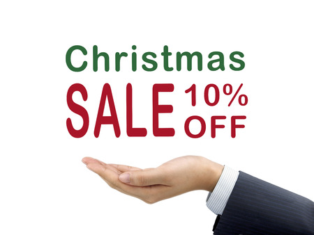 10 month: Christmas sale 10 percent off holding by businessmans hand over white background