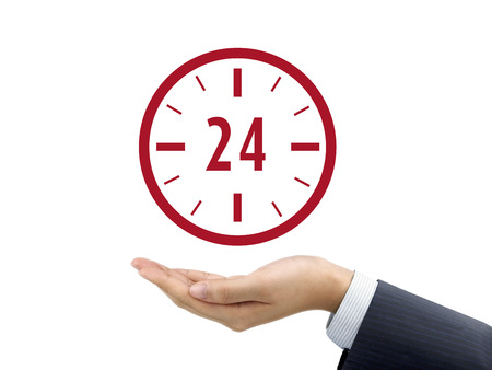 24 hours: 24 hours service icon holding by businessmans hand over white background Stock Photo