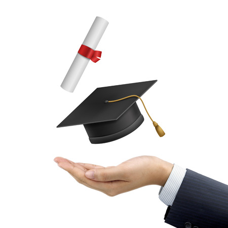 thesis: businessmans hand holding a graduation hat and diploma over white background