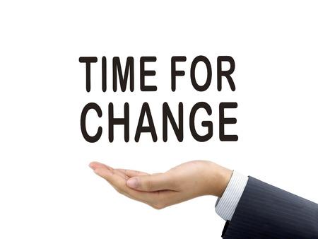 firmeza: tiempo de las palabras del cambio sostienen por la mano del hombre de negocios sobre el fondo blanco