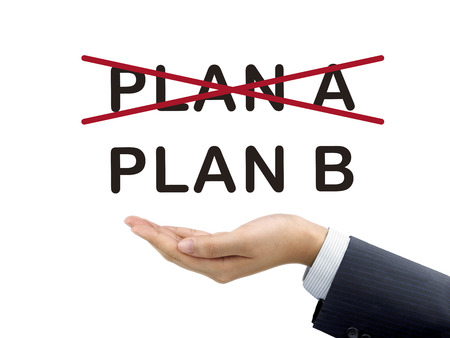 plan b: plan B holding by businessmans hand over white background Stock Photo