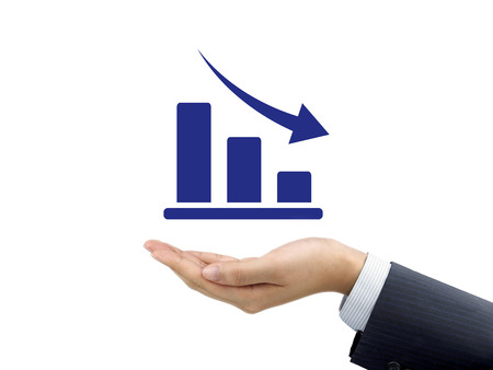 the decline: decline graph holding by businessmans hand over white background Stock Photo