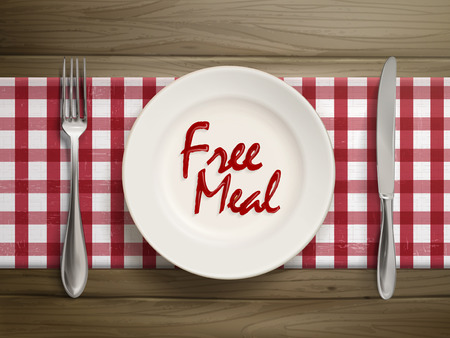 free plate: top view of free meal written by ketchup on a plate over wooden table