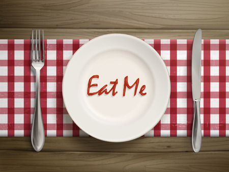 eat me: top view of eat me written by ketchup on a plate over wooden table