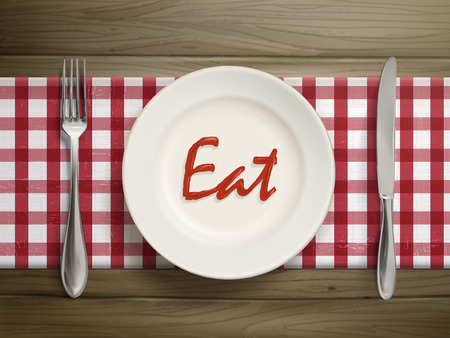 dinner setting: top view of eat word written by ketchup on a plate over wooden table