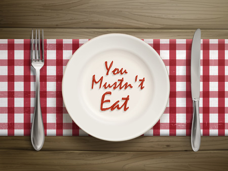 top view of you must not eat written by ketchup on a plate over wooden table