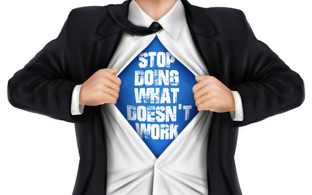 underneath: businessman showing Stop doing what doesnt work words underneath his shirt over white background