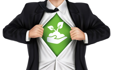 underneath: businessman showing growth icon underneath his shirt over white background