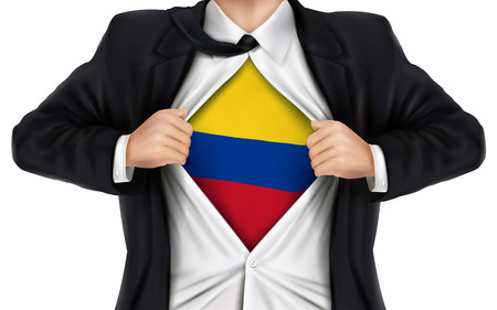 colombia flag: businessman showing Colombia flag underneath his shirt over white background