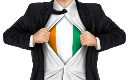 underneath: businessman showing Ivory Coast flag underneath his shirt over white background