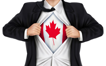 underneath: businessman showing Canada flag underneath his shirt over white background