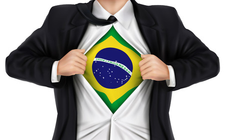 underneath: businessman showing Brazil flag underneath his shirt over white background