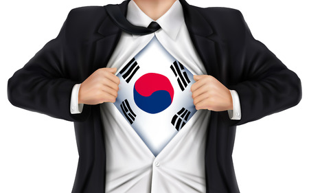 underneath: businessman showing South Korea flag underneath his shirt over white background