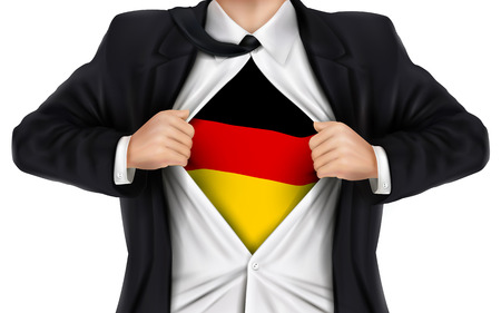 underneath: businessman showing German flag underneath his shirt over white background