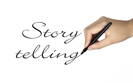 telling: story telling words written by human hand over white