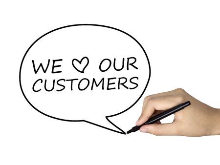 人間の手によって書かれた吹き出しで我々 の顧客の言葉を愛します。 写真素材
