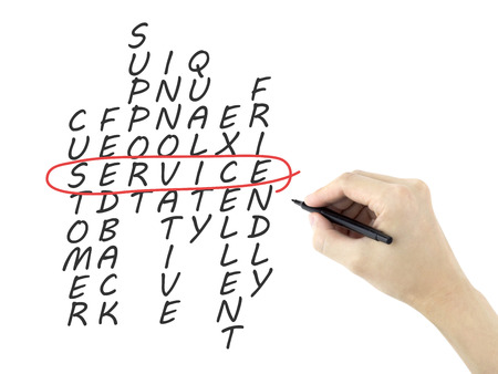 service crossword written by mans hand on a white board photo
