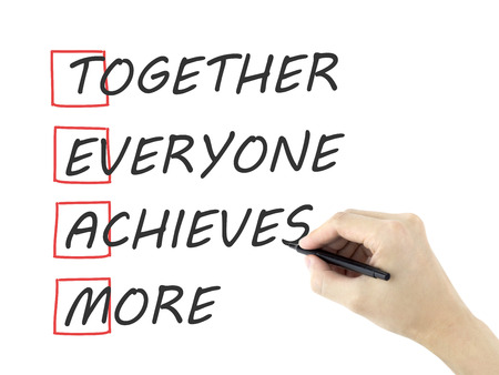 achieves: Together Everyone Achieves More written by mans hand on white background Stock Photo