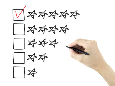 satisfactory: mans hand putting check mark with pen on five star rating