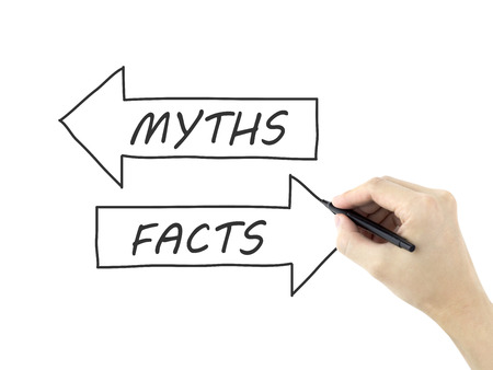 myths: myths or facts words written by mans hand on a white board