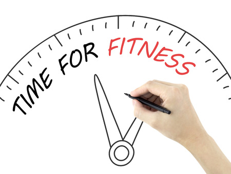 fitness goal: time for fitness written by mans hand on white background