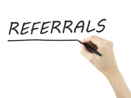 referral marketing: referrals word written by mans hand on a transparent board Stock Photo