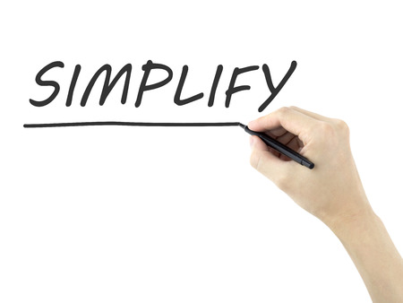 simplify word written by mans hand on white background photo