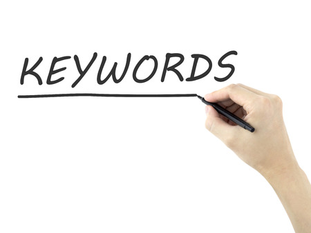 keywords word written by mans hand on white background Stock Photo