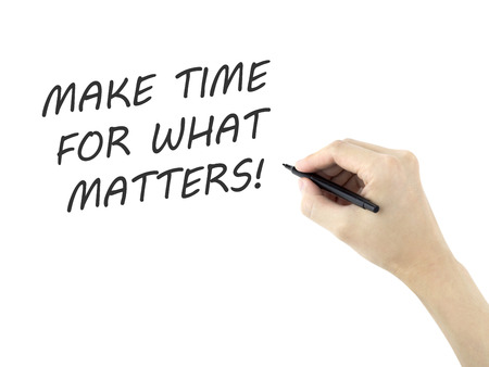 matters: make time for what matters written by mans hand on white background
