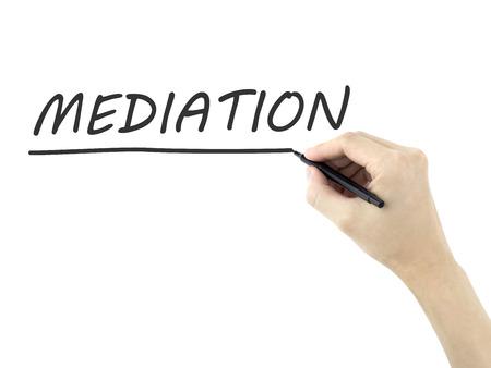 mediation: mediation word written by mans hand on white background