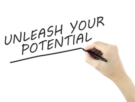 unleash: unleash your potential words written by mans hand over white background