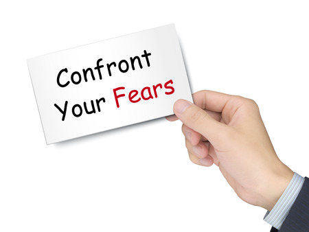 confront: confront your fears card in hand isolated over white background Stock Photo