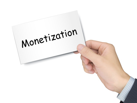 monetize: monetization card in hand isolated over white background Stock Photo