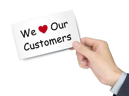 白い背景で隔離の手で私たちの顧客カードを愛します。