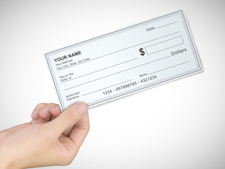 blank check: business concept: mans hand holding a check over grey background Stock Photo